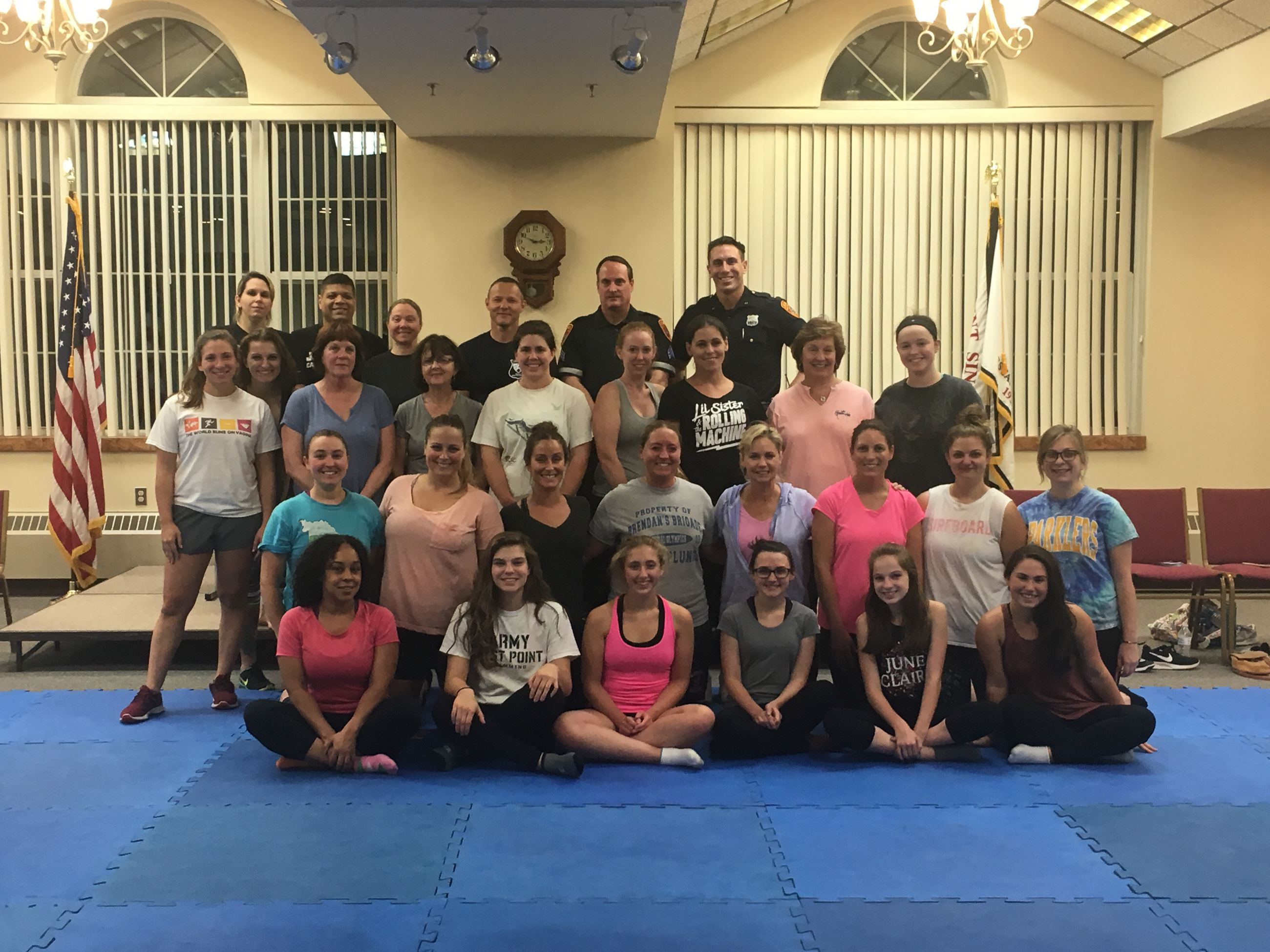Group photo of participants in self-defense class.