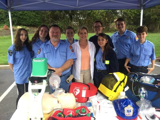 Legislator and volunteer EMTs at MPFD open house.