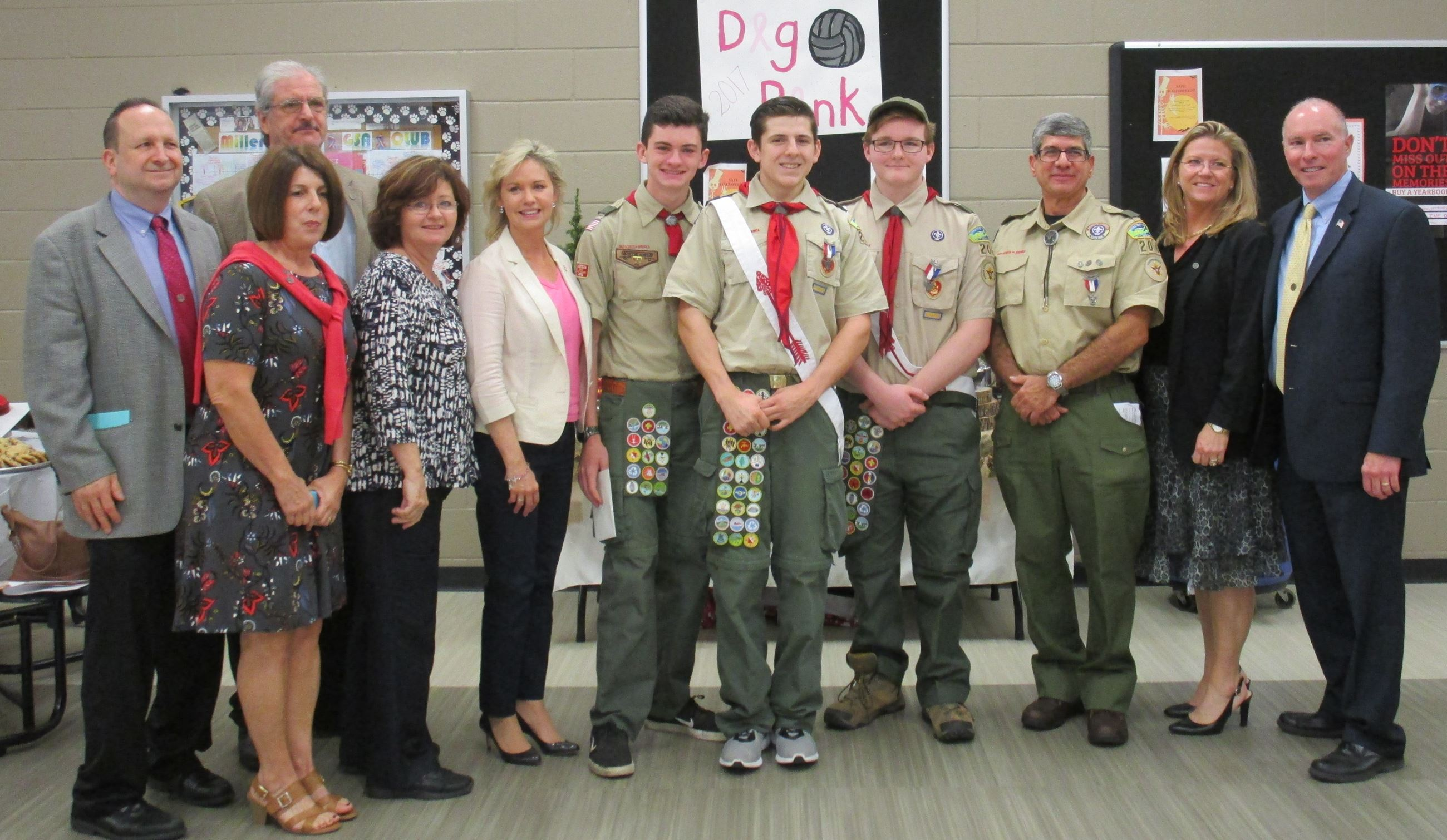 Eagle Scouts, their parents, and Legislator Sarah Anker.