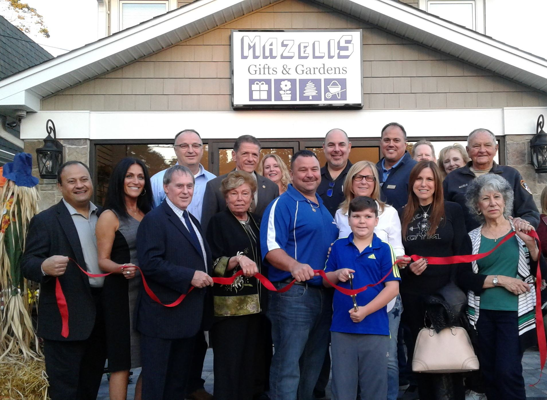 Greater Smithtown Chamber of Commerce members and public officials attend grand opening of Mazelis G