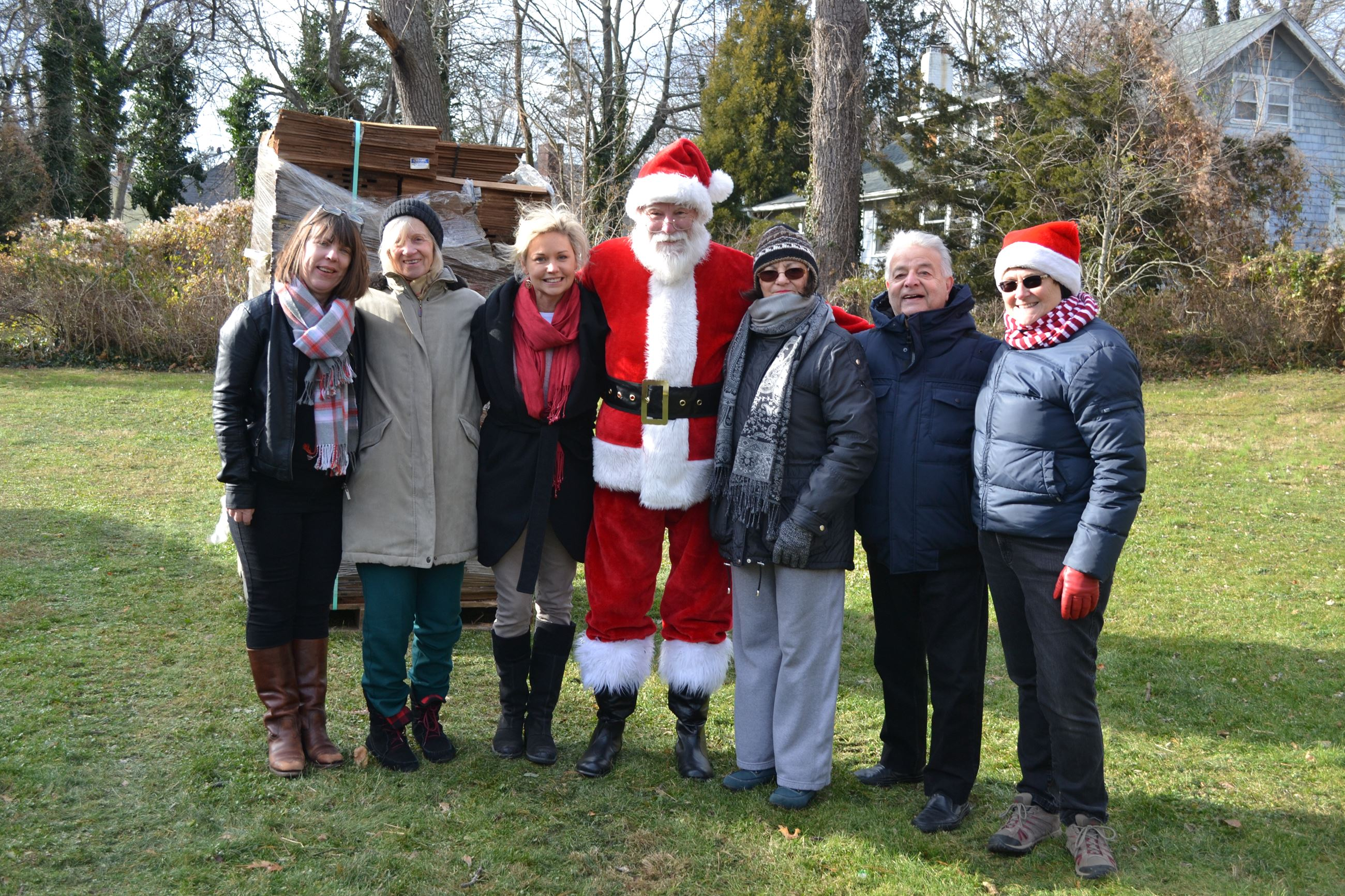 Legislator Anker with Santa and members of the historical society.