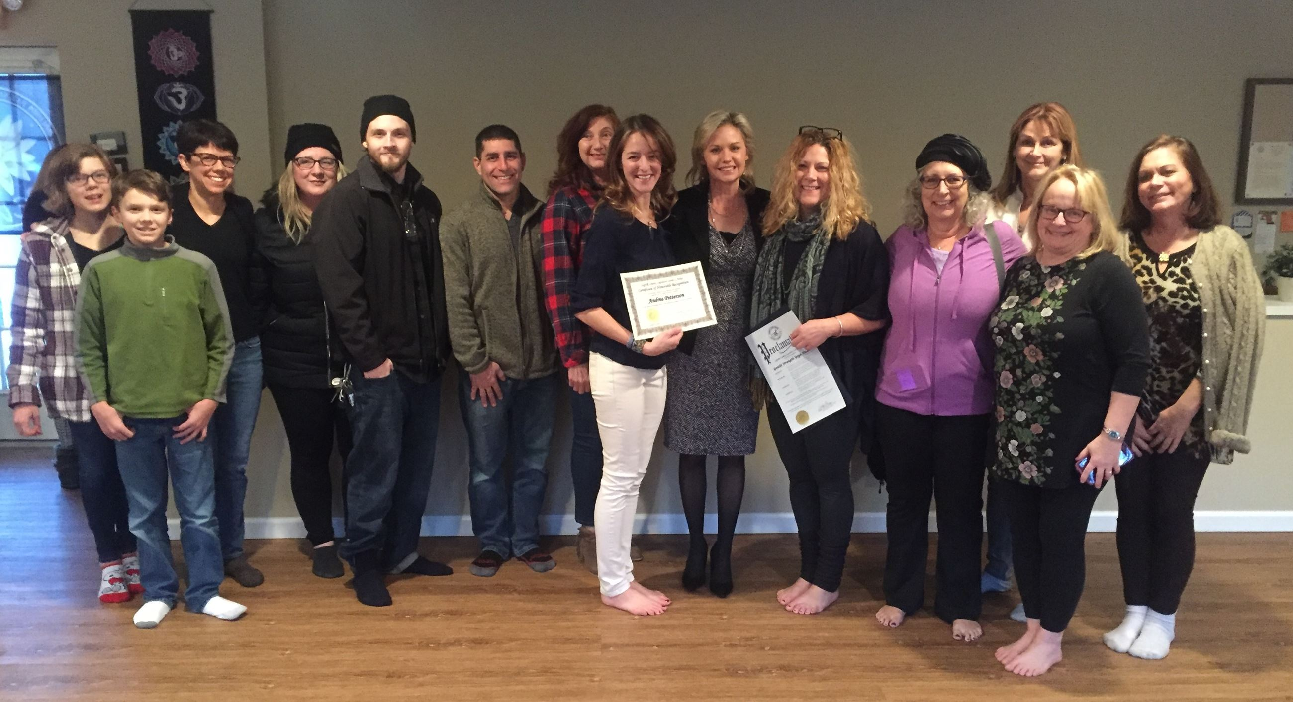 Legislator Anker honors Gentle Strength Yoga Studio with a proclamation.